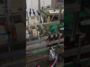 4 galvas mazu pudeļu šķidruma pildīšanas mašīna